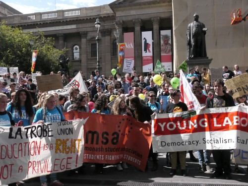 Students stand on the steps of Melbourne State Library. Photo by Julia Pillai.