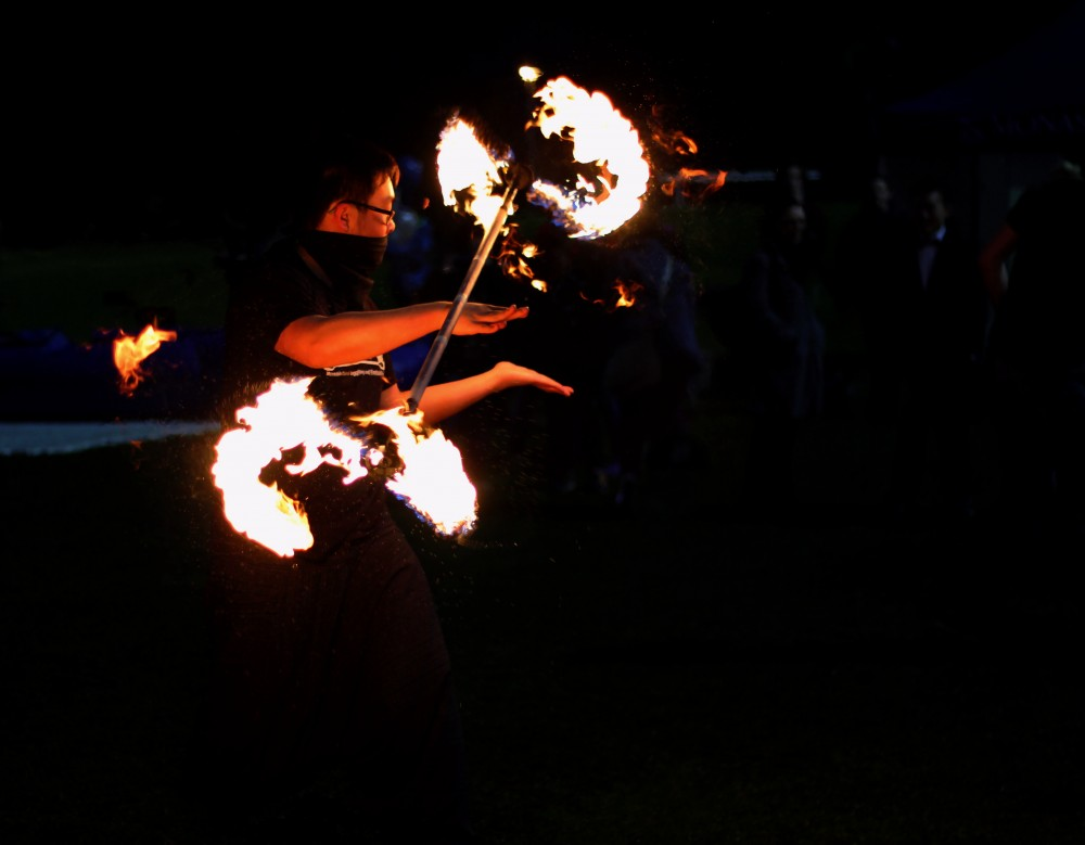 A member of the Monash Club of Juggling and Fire Twirling shows off his skills